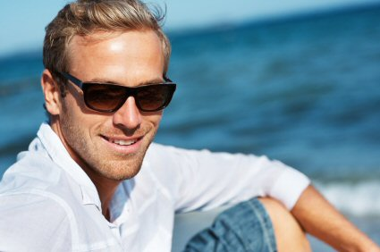 Man at beach with sunglasses